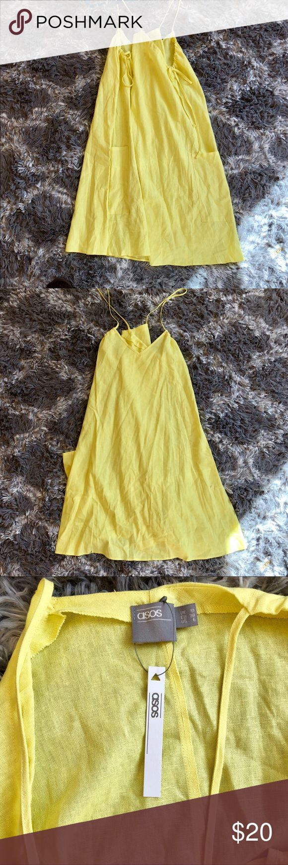 Yellow ASOS Summer Dress This yellow ASOS dress is new with tags. The straps are adjustable and tie on the side along with two large pockets. The material is very breathable and the fit is very loose. Tobi Dresses Mini