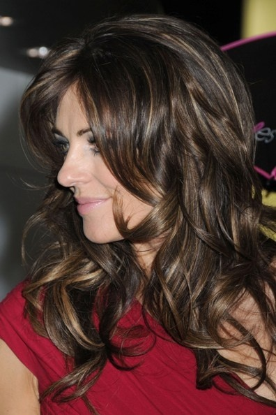 Elizabeth Hurleys wavy, brunette hairstyle hair-and-beauty