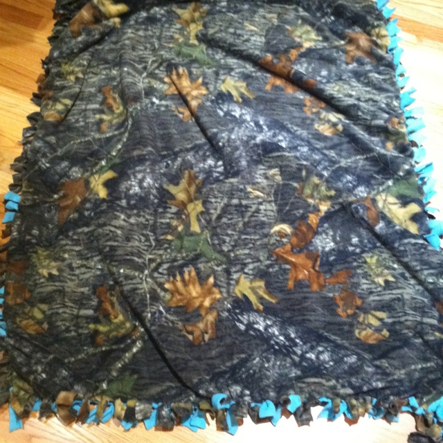 Homemade sleeping bag. Two fleece blankets, cut, then tied together by knots