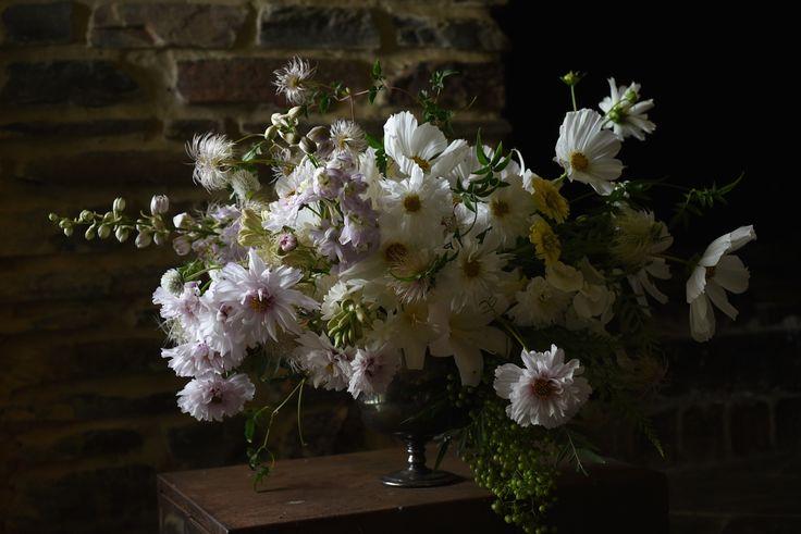 white cosmos, delphinium, creamy yellow zinnias, green peppercorn, fern