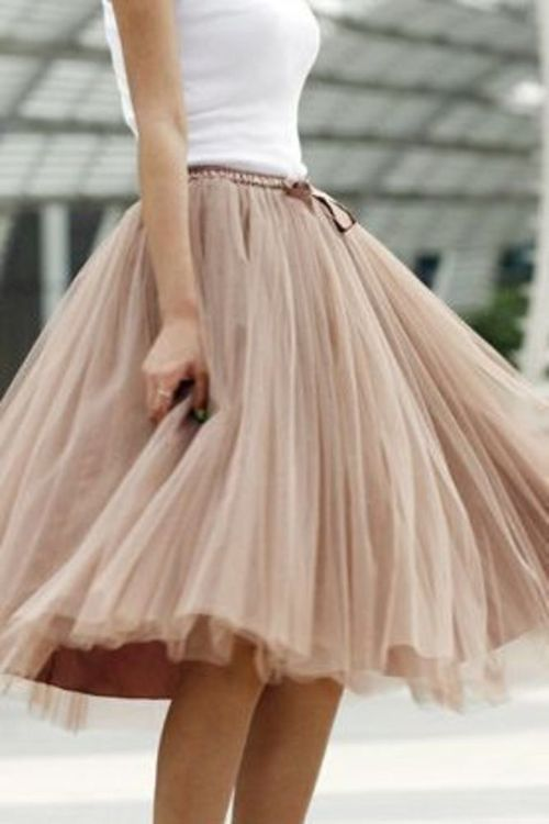 "One of the ""must haves"" for 2014: tulle. Perhaps a tulle skirt in a soft faded pink, something similar to this, or faded blue for a wedding?"