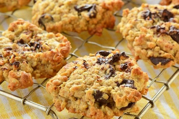 """A chewy oatmeal cookie with chocolate chips, shredded coconut, and chopped nuts. Great with or without nuts and coconut.""  Ingredients     	1 cup butter, softened   	1 1/4 cups packed brown sugar   	1/2 cup white sugar   	2 eggs"