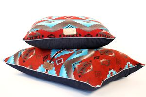 Red fleece dog bed with southwestern patterns by Gitli Goods
