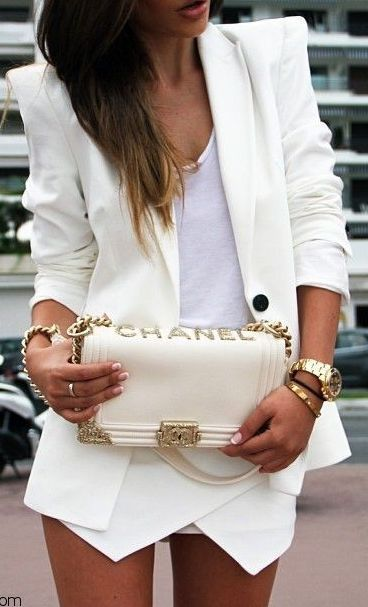 Street fashion in white with handbag by Chanel