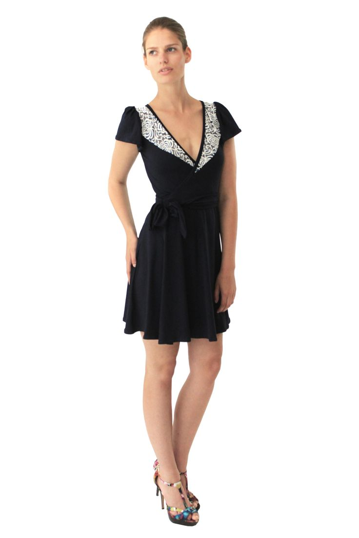 Dark navy blue wrap dress with delicate blue and white lace panels at the front neckline. Ties around the waist and has slight puff short sleeves.