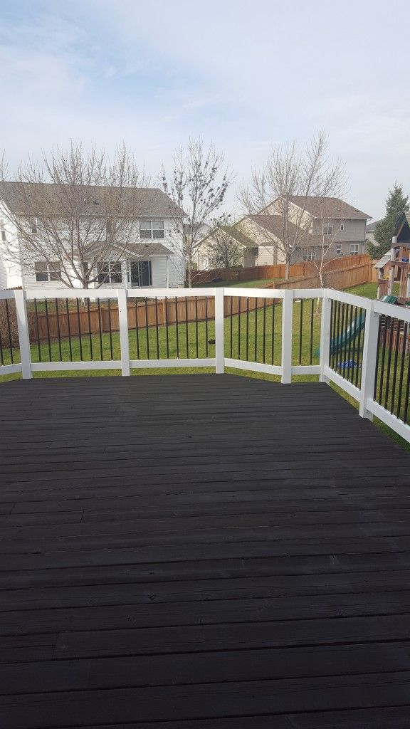 We foresee many fun family gatherings, days lounging in the sun, watching the kids play and grilling on this gorgeous deck. The white railings contrast beautifully against the rich stain of the deck painted in Black Aider SW 3022.