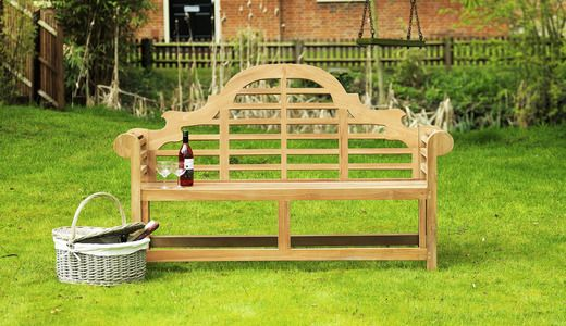 Add a touch of elegance to your garden with this beautiful teak bench which features scrolling arms and a charming arched back.