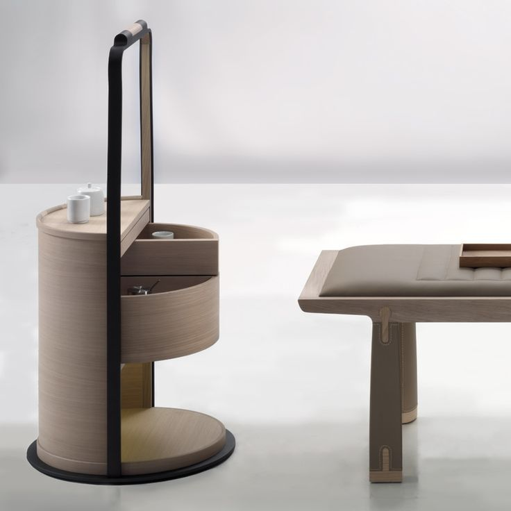 The SIMA bedside cabinet goes beyond the basic functionality of a nightstand to include a hanging rail.