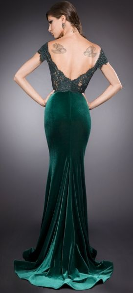 Beautiful green velvet gown. Image from Frou Frou Fashionista.