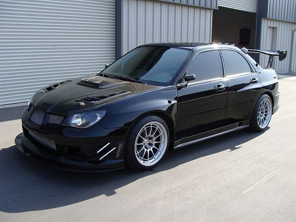 Tuned Subaru Impreza WRX STi 2006... luv them wheels! Nice touch with the reverse vents and scoop on the hood.