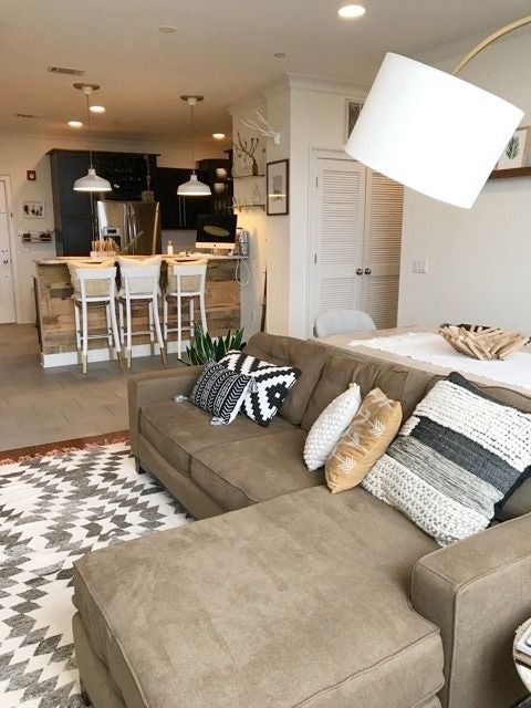 Neutrals like brown and tan tones don't have to be boring, layering different textures and mixing in pops of crisp white keep things stylish and modern.
