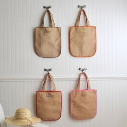Our stylish and earth friendly personalized Southampton Jute tote lets you go to the beach or farmer's market in style. Don't let the slim, simple design fool you! There's plenty of room in the spacious main compartment for all your daily essentials. Made from sustainable natural jute fiber, the bag and handles are cotton lined for comfort. Choose from one of our four lining colors and 15 signature thread colors.