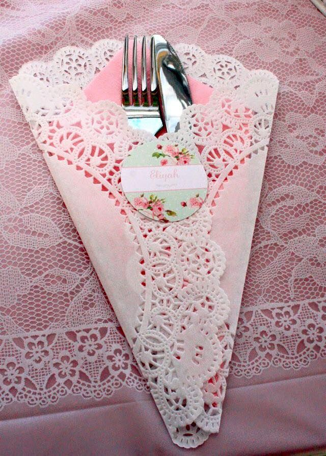 Wrap silverware in doilies with pastel colored napkin inside and pretty sticker to secure