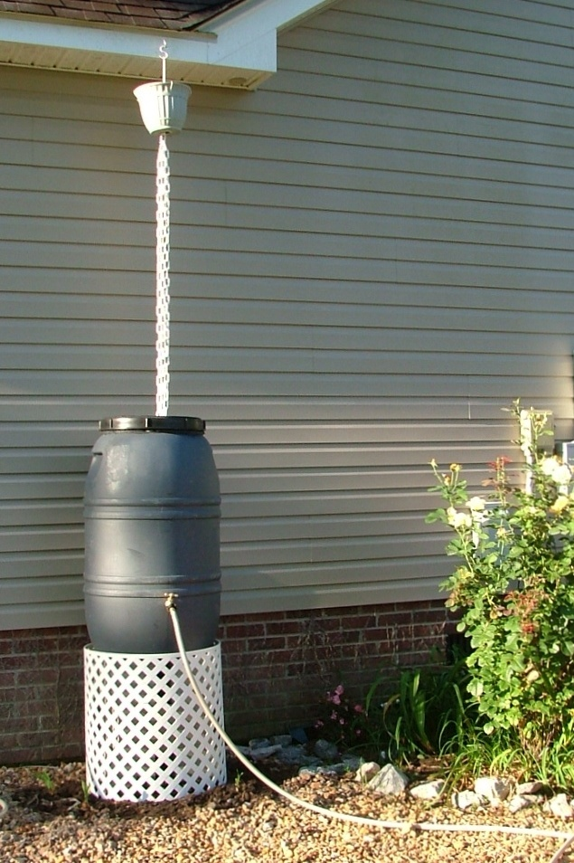 My Rain Chain and Rain Barrel, sitting on cinderblocks with wire tied plastic lattice to cover base.  I did another one where I made the lattice base a little wider and the hose wraps up and stores inside.  rain chain and rain barrel
