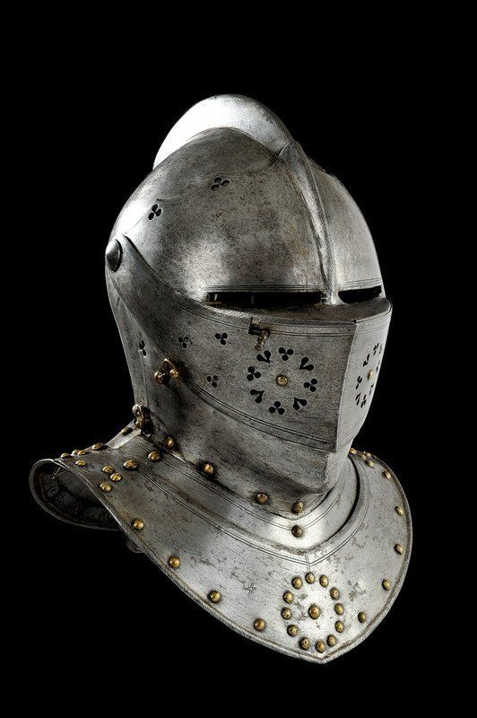 Nuremberg combat close-helmet  circa 1600, Southern Germany. One-piece skull with low file-rope comb, pointed visor and upper and lower bevors pivoted at the same points on both sides, the cusped upper edge pierced with trefoils, the upper bevor perced with trefoils and hearts, rass locking hook and stud; two front and rear gorget-plates, the lower ones with turned rope-edge, the front-plate with Nuremberg mark and maker's mark. Double line decoration on nearly all parts. Brass plume-holder.