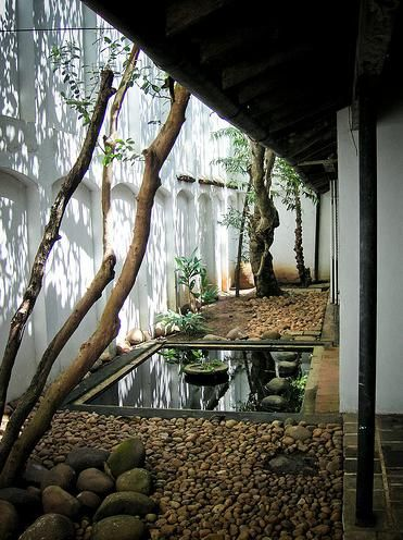 courtyard..rain water filters through rocks into a gray water system so that there is no flooding.