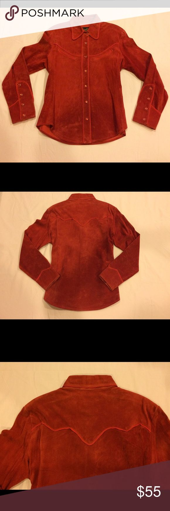 """Scully Shirt/Jacket Gorgeous burnt orange color!! In very good used condition.  Tapered waist with a very flattering fit. Thick matching thread that outlines the front and back yoke, the chest pockets, the placket and the very decorative cuffs. Snap buttons match the suede, 7 down the front and 4 on each cuff.  The are some minor scuffs on front lower part, see pic. The cuffs have some wear, not anything detracting, inside is a 1/4"""" stain that can't be seen through the leather. See comments…"""