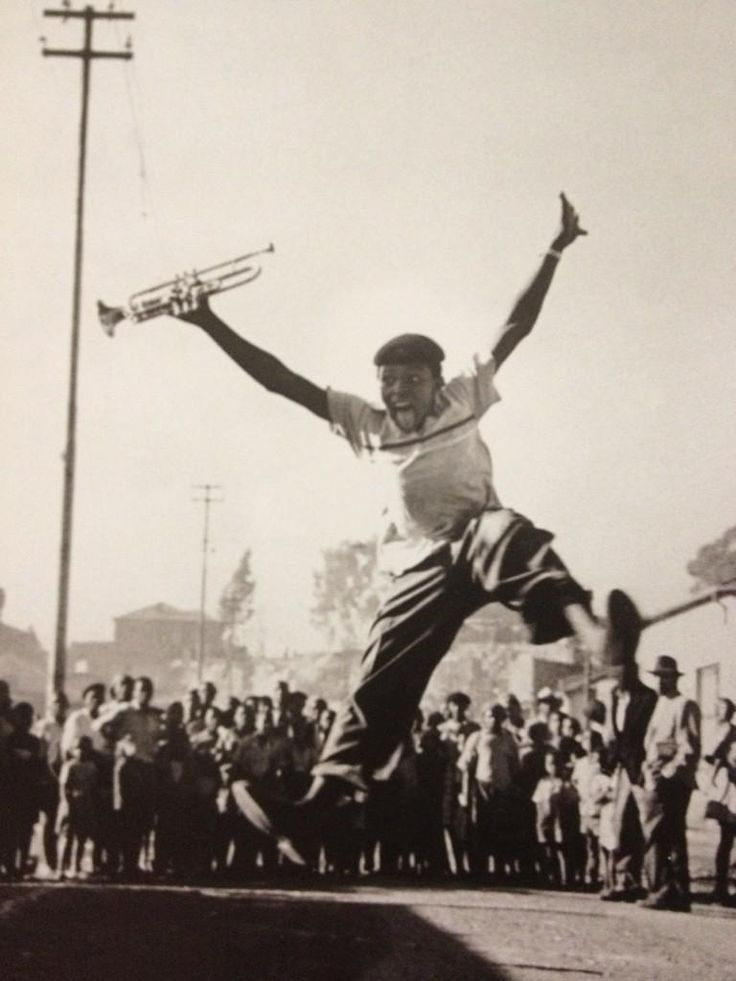 Alf Khumalo's photo of jazz artist Hugh Masekela, after receiving a trumpet from Louis Armstrong. Around 1953