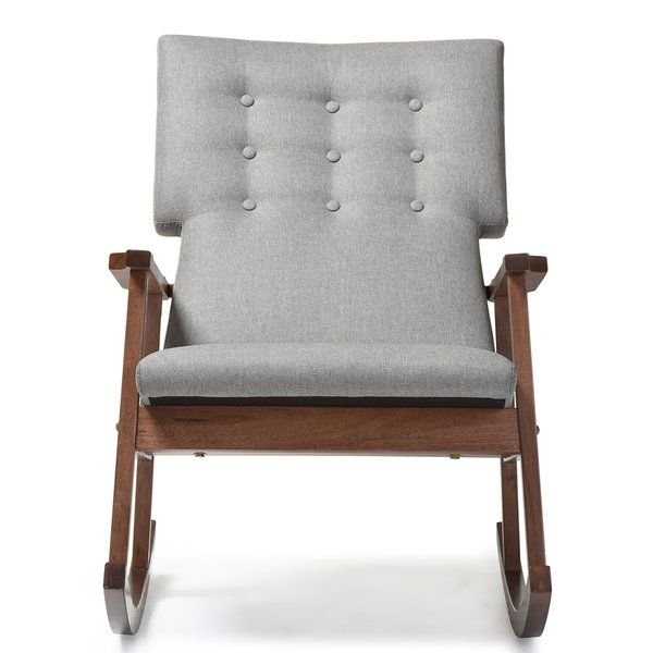 Featuring Scandinavian style with modern aesthetic, the Nikanor rocking chair features upholstered high back cushioned seat with button tufting design. The rocking base of the chair is constructed of solid rubberwood in dark walnut finishing for a truly retro feel. The sculpted armrests provide strong support for extra comfort after a long day. This piece, looks smart, modern, but comfortable can be a good rocking chair for nursery during middle of the night feedings and yet a pretty piece…