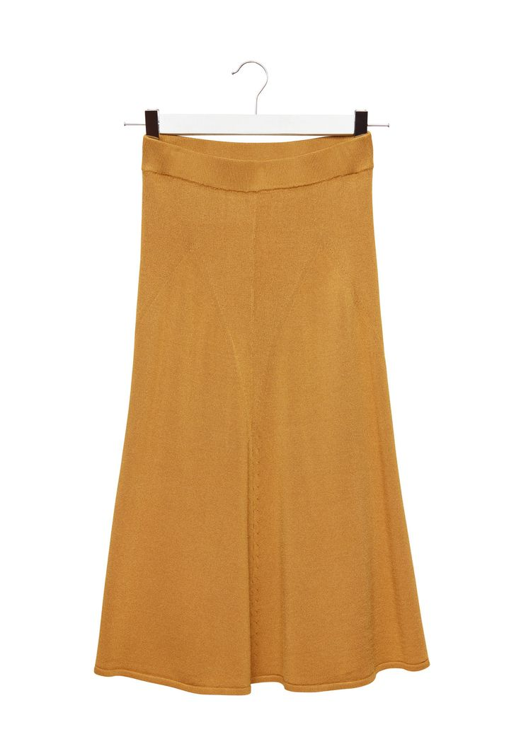 Shiny effect viscose midi skirt. The soft, flowing fabric creates wavy pleats. Tight-fitting design at the hips, loose and flared at the hem. Length below the knee.