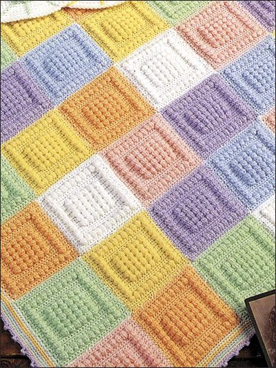 Bubble Squares Baby Blanket--Looks like a pretty simple pattern, same concept as the Caron ABC Blanket (if you know it).  I would make this in strips, rather than individual squares--just because squares are a pain in the rear!