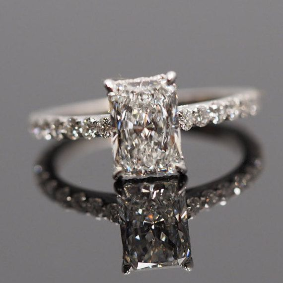 Radiant Cut Engagement Ring Setting with Diamonds on the bar (under the diamond) and along the band. Share U Prong Setting. *All Diamonds are set