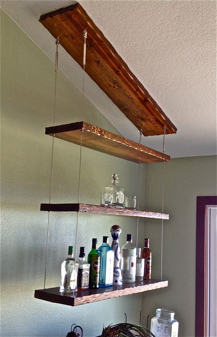Distressed hardwood and stainless cable suspended liquor ...