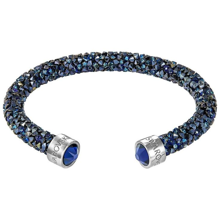 Swarovski Crystaldust Cuff, Blue, S 5255911. Crafted using our Crystal Rock technique,. It is lavishly encrusted with brilliant blue crystals for unparalleled sparkle. Wear alone as a perfect finishing touch or layer with others for maximum impact.