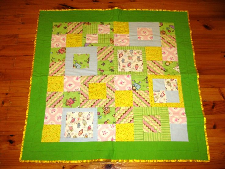 Scrappy flannel cot quilt with satin binding (for charity).