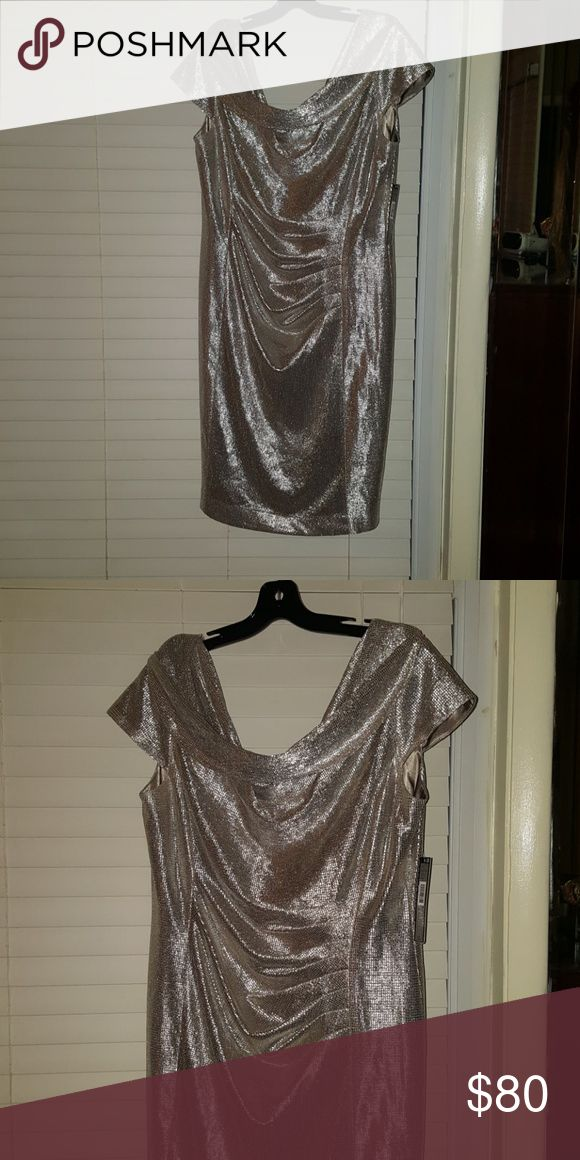 Tahari brand new metallic jumper Brand new with tags. Silver metallic jumper. Size 16 Knee length Tahari Dresses
