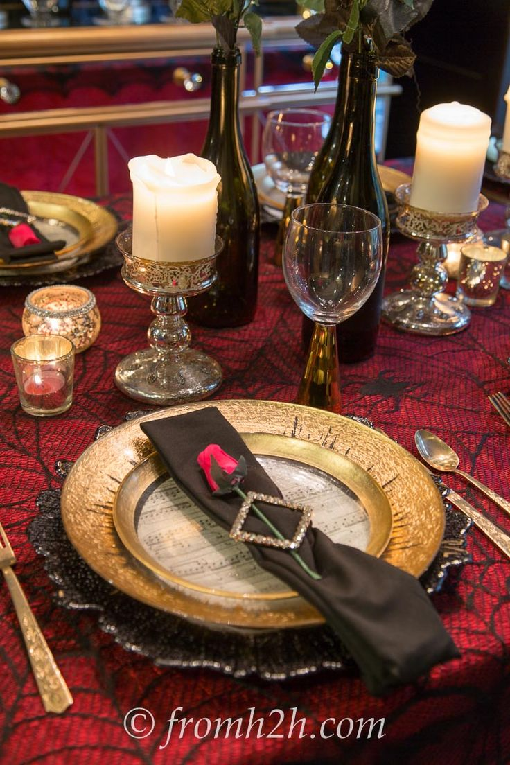Gold, black and red table setting perfect for a Phantom of the Opera party...with free printable for the music score plate decor.