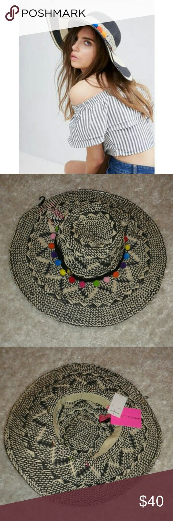 Betsey Johnson floppy straw hat with pompoms NWT. Black and cream straw raffia hat with multicolored poms. No flaws. Never worn...a bit different print on hat, but same floppy style. Betsey Johnson Accessories Hats