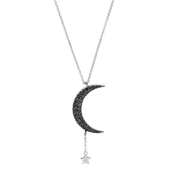 Capture the moon and stars when wearing this ethereal Meira T necklace. The black diamond encrusted moon has a white diamond star hanging from it, taking this symbol from antiquity to modern. This Meira T necklace is perfect for your nightly attire.   Diamond Weight: .32 cts