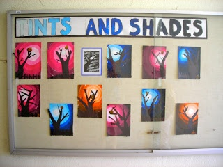 A great art project to combine the ideas of foreground/background, silhouettes, and then really a lesson about tints and shades of colours.  Looks SO great ... you could really change the image of a tree to anything that relates to what you're up to in the classroom!