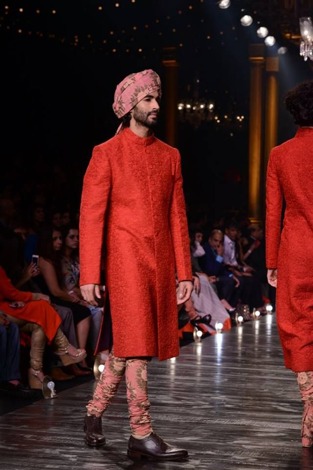 By designer Sabyasachi, a complete thread work red sherwani with printed bottoms. Shop for your wedding trousseau, with a personal shopper & stylist in India - Bridelan, visit our website www.bridelan.com #Bridelan #Indiangroom #Sabyasachi