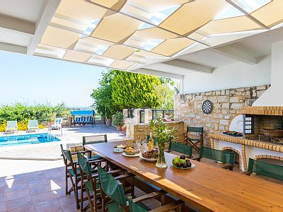 Rethymno villa rental - BBQ facilities and shaded dinning area.