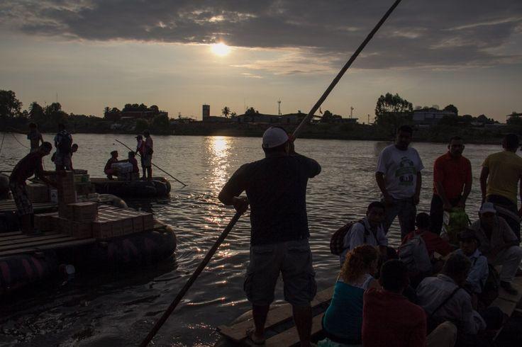 immigrants crossing the sachet river, a natural border between Mexico ...