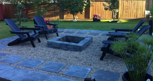 Square fire pit with pea stone gravel and charcoal slate gray patio blocks complimented with stained ebony adirondack chairs (that were old and required a facelift).