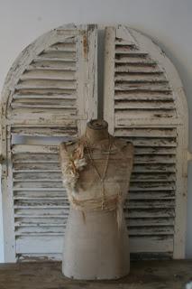 Servies en Brocante ...arched shutters....