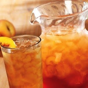 I love this stuff! Olive Garden® Bellini Iced Tea    1/2 oz. Monin Peach syrup  1/2 oz. Monin Raspberry syrup  8 oz. brewed tea, chilled  Ice    Garnish:    Fresh Peach slices  Raspberries     Combine chilled tea and syrups in a tall glass filled with ice and stir well.  Garnish with peach slice or raspberries. by Lettyrose