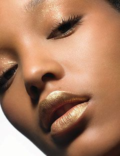 model in gold lipstick and shadow