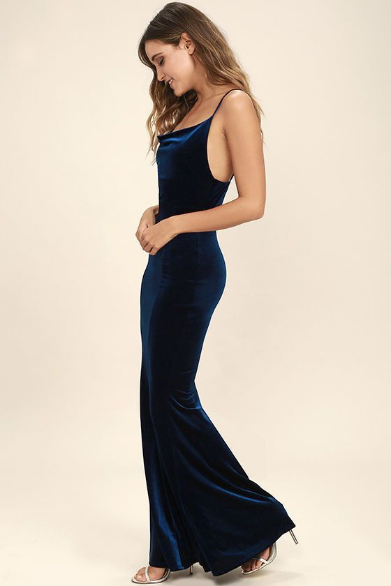 You don't need magical powers to cast a spell on that special someone, just slip into the Sorceress Navy Blue Velvet Maxi Dress! Soft and stretchy velvet is absolutely enchanting across skinny straps, a draping neckline, and a figure flaunting maxi skirt with a mermaid hem.