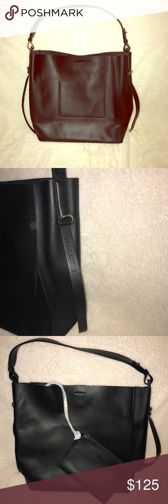 """AllSaints Paradise North/South Leather Tote Beautiful AllSaints Tote New with defect There is a surface scratch/cut on one side. Please see picture. Because of the position I do not believe it would affect the life.  Adjustable shoulder strap - Magnetic closure; lined - Interior slip pocket - Removable zip pouch - 13.5""""W x 5.5""""D x 14.5""""H; 8"""" strap drop  - Cow leather All Saints Bags Totes"""