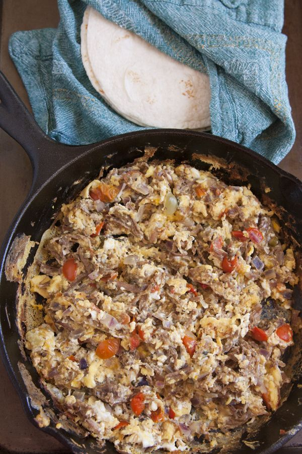 Machaca con Huevo (Machaca with Eggs) - Tender shredded beef combined with scrambled eggs, tomatoes, and onions make a delicious skillet breakfast or breakfast burritos.