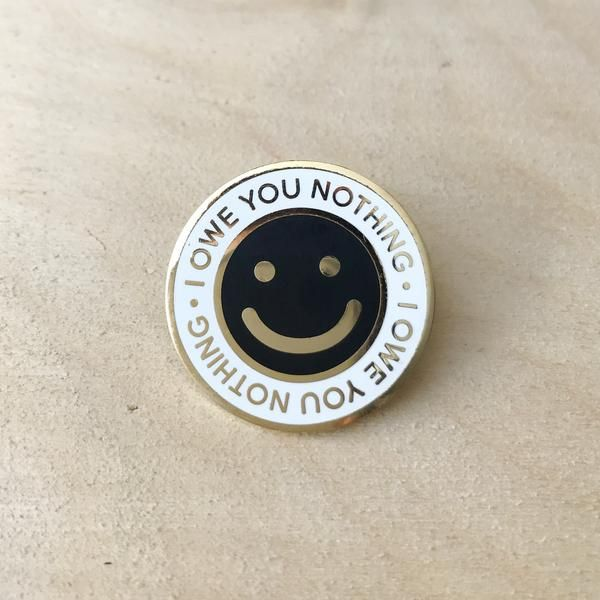 """One of our favourite pieces! A cheeky smiley face featuring jewelry quality gold plating. 1"""" lapel pin Complete with rubber clutch closure"""