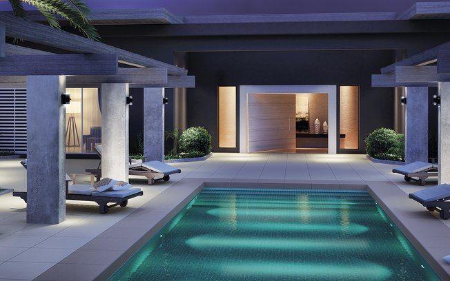 A iluminação subaquática garante um ar mais dramático à piscina à noite. Revestimentos, Eliane. Foto: Divulgação