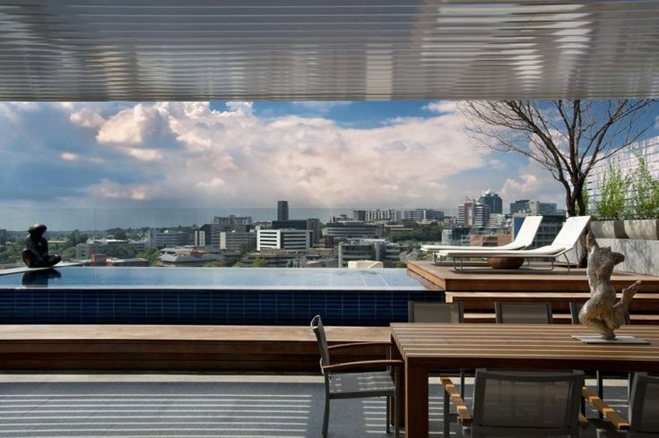 Cape Town-based studio SAOTA – Stefan Antoni Olmesdahl Truen Architects has completed the Sandhurst Towers penthouse project, in collaboration with interior design studio OKHA Interiors.  This luxury 9,700 square foot triplex penthouse is located in the Sandhurst towers in Johannesburg, South Africa and has its own roof garden with swimming pool!