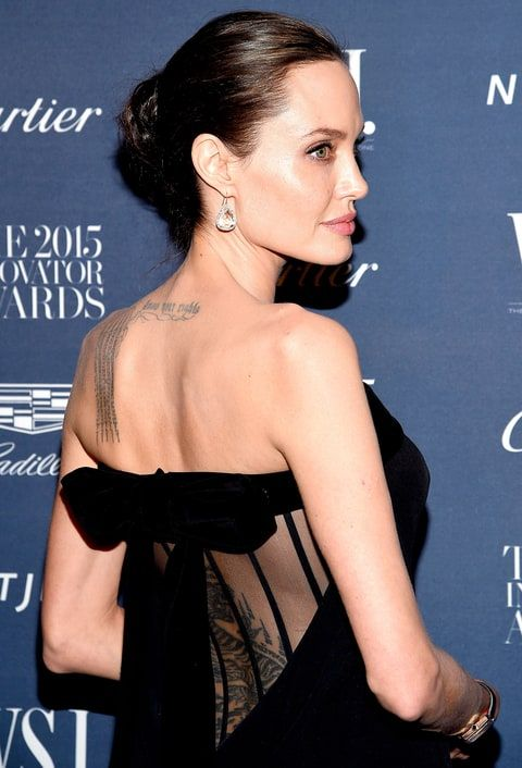 best icon angelina jolie images angelina jolie angelina jolie was spotted three new back tattoos while filming her war drama first