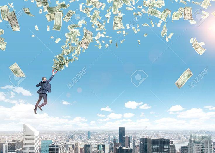 A Young Businessman Flying Over Paris With A Magnet In Hand That Is Pulled To Money Tornado. Paris And Blue Sky At The Background. Concept Of Strivig For Wealth. Fotos, Retratos, Imágenes Y Fotografía De Archivo Libres De Derecho. Image 51753508.