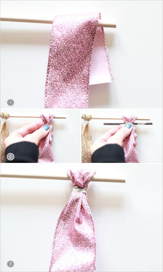 How To Make A Ribbon Backdrop  1. Cut ribbon in to four foot strips and fold 2 inches of ribbon over the dowel 2. Pinch the ribbon and secure with a twist tie 3. Flatten the twist tie so ribbon is as flat as possible. Repeat until your dowel is full. That's it! Super easy right? Enjoy.
